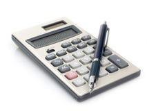 Calculadora e pena Imagem de Stock Royalty Free