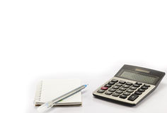 Calculadora e pena e caderno Fotos de Stock