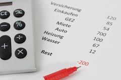 Calculadora e uma pena vermelha Fotos de Stock