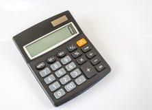 Calculadora electrónica en el fondo blanco Fotos de archivo libres de regalías