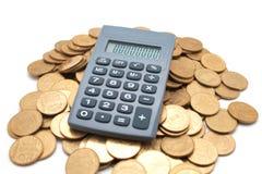 Calculadora em moedas Foto de Stock Royalty Free