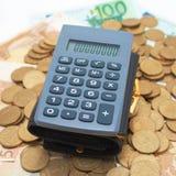 Calculadora em moedas Imagem de Stock