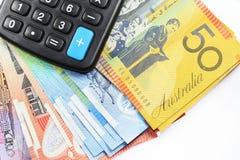 Calculadora en el dinero Imagen de archivo