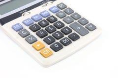 Calculadora en el fondo blanco Imagen de archivo libre de regalías
