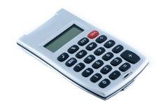Calculadora en el fondo blanco, aislado Fotos de archivo libres de regalías