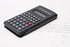 Calculadora en fondo del dibujo de estudio fotos de archivo libres de regalías