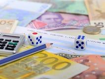 Calculadora europea de la ruleta de los dados de la moneda del dinero Foto de archivo