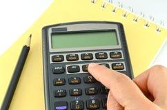 Calculadora financeira da pressão de mão Imagem de Stock