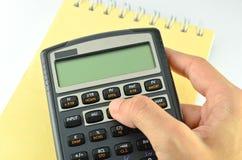 Calculadora financeira da pressão de mão Fotografia de Stock