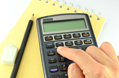 Calculadora financeira da pressão de mão Fotos de Stock