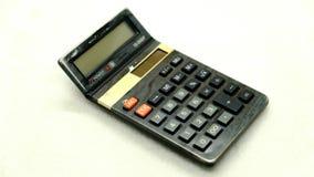 Calculadora isolada no fundo branco, dispositivo para calcular os números Fotografia de Stock Royalty Free