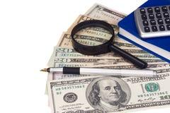 Calculadora, libro y dólares Imágenes de archivo libres de regalías