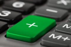Calculadora más el botón Imágenes de archivo libres de regalías