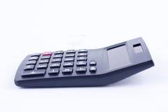 Calculadora para calcular el cálculo de negocio de la contabilidad de los números que considera sobre el fondo blanco Fotos de archivo