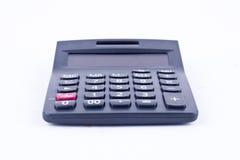 Calculadora para calcular el cálculo de negocio de la contabilidad de los números que considera sobre el fondo blanco aislado Fotos de archivo libres de regalías