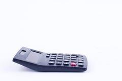 Calculadora para calcular o cálculo de negócio explicando da contabilidade dos números no fundo branco isolado Fotografia de Stock Royalty Free