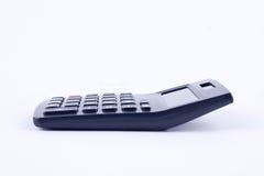 Calculadora para calcular o cálculo de negócio explicando da contabilidade dos números no fundo branco isolado Imagens de Stock