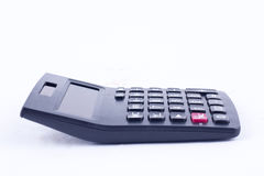Calculadora para calcular o cálculo de negócio explicando da contabilidade dos números na opinião lateral do fundo branco Fotografia de Stock Royalty Free