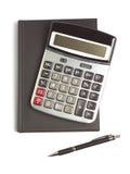 Calculadora, pluma y diario Imagenes de archivo