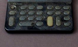 Calculadora polvorienta y sucia vieja Imágenes de archivo libres de regalías