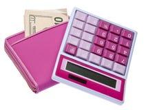Calculadora rosada con la carpeta llenada dinero imagenes de archivo