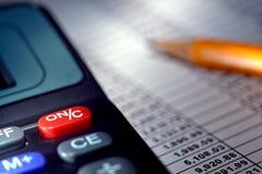 Calculadora sobre o Spreadsheet Fotografia de Stock Royalty Free