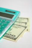 Calculadora verde com dólares 2 Fotos de Stock