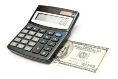 Calculadora y 100 dólares Imagen de archivo libre de regalías
