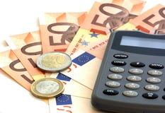 Calculadora y billetes de banco euro Fotos de archivo libres de regalías
