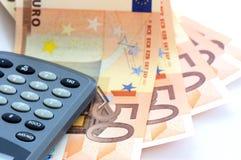 Calculadora y billetes de banco euro Fotografía de archivo libre de regalías