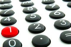 Calculadora y buttom rojo Fotos de archivo
