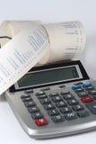 Calculadora y cinta Fotografía de archivo libre de regalías
