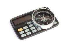 Calculadora y compás Foto de archivo libre de regalías