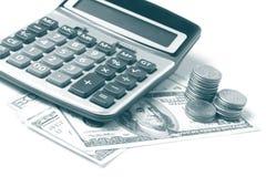 Calculadora y dólares Foto de archivo libre de regalías
