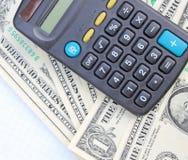 Calculadora y dólares Fotografía de archivo libre de regalías