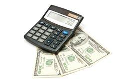 Calculadora y dinero Imagen de archivo libre de regalías