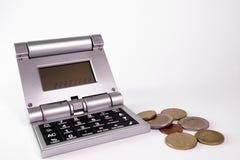 Calculadora y dinero Imágenes de archivo libres de regalías