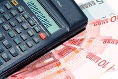 Calculadora y dinero Fotografía de archivo