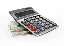 Calculadora y dinero de $20 billetes de banco Imagen de archivo libre de regalías