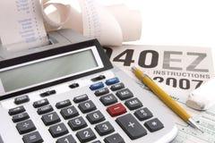 Calculadora y estación del impuesto Fotografía de archivo