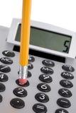 Calculadora y lápiz Imagen de archivo libre de regalías