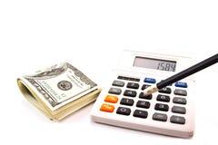 Calculadora y lápiz y dólares Fotografía de archivo libre de regalías