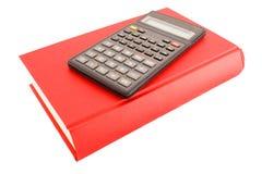Calculadora y libro rojo Fotografía de archivo libre de regalías
