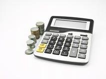 Calculadora y moneda Fotos de archivo