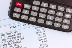 Calculadora y nómina de pago Foto de archivo libre de regalías