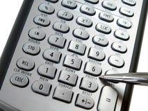 Calculadora y pluma de plata Fotografía de archivo