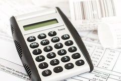 Calculadora y recibos Imagen de archivo