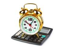 Calculadora y reloj Imagen de archivo libre de regalías