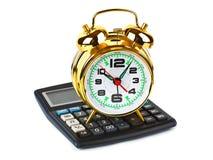 Calculadora y reloj Fotos de archivo libres de regalías