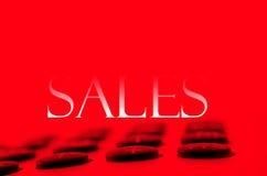Calculadora y ventas Fotos de archivo